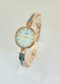 Damski zegarek ze złotą bansoletą